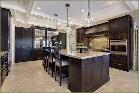 brown kitchen cabinets with black countertops impressive home design