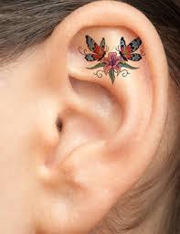 two butterflies on flower ear tattoomodels ear