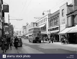 a view down commercial road in portsmouth during the 1950s england
