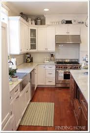 How To Decorate Above Cabinets Pictures Kitchen Cabinet Decorations Free Home Designs Photos