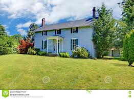 two story house with blue exterior paint and small open porch