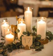centerpieces with candles candles in water centerpieces floating flowers and use filled