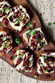 how to canapes brie and pomegranate crostini recipe appetizers food