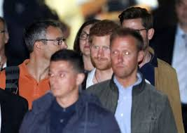 pics prince harry sad without meghan markle in australia