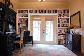 furniture white stained wood built in book shelf around glass