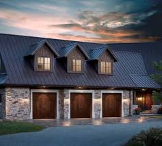 above garage door traditional with stone wall roof shingles
