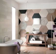 love the giant quilt effect of the wall tile bathrooms