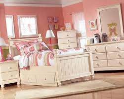 bedroom dark varnished wooden trundle bed combined peach wall
