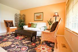 Rustic Living Room Paint Colors by Simple Rustic Living Room Interior Design Featuring Orange Theme