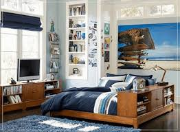 small bedroom setup platform bed with tufted headboard navy blue