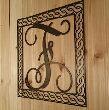 iron on monogram initials wall hanging metal vine monogram initial with detailed rope border