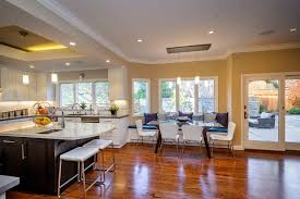 mixing cabinet colors kitchen transitional with dining banquette