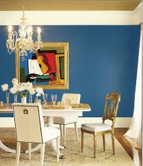 dining room blue painted wall with brown metal chrome chandelier