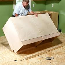 how do you attach island cabinets to the floor how to install cabinets like a pro the family handyman