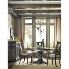 round single pedestal dining table with decorative nailhead trim