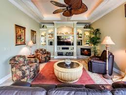 tropical living room with crown molding by adrian waring zillow