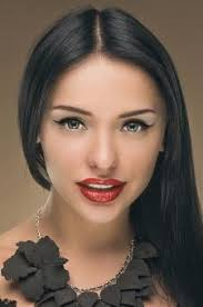 eyes and um brown hair woman with olive skin and red lipstick