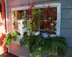 Decorating Outside Window Christmas Wreaths by Christmas Window Decoration Ideas With Garlands Candles And