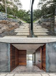 Covered Garage by A Butterfly Roof Contains This House On A Hillside In Mexico