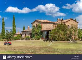 big brick house in the countryside of tuscany italy rural stock
