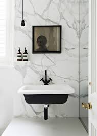 Wall Mounted Sinks Bathroom With Wall Mounted Sink And Marble Walls The Wall