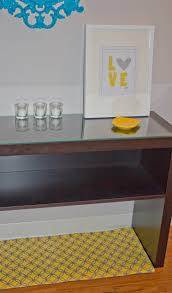 nice entryway table ideas with glass on top and storage design