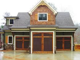 plan 92369mx 3 car rustic garage with living above garage