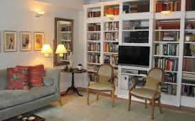 fascinating wall sconces living room shelf full of books and the