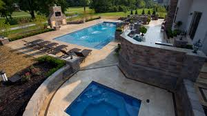 Outdoor Entertainment Center by The Clearwater Group Landscape Patio Pool Spa Pavers Lighting