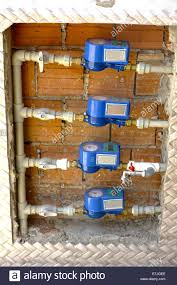 gas meter bank outside of house stock photo royalty free image