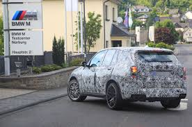 Bmw X5 Generations - next bmw x5 spotted sheds more disguise ahead of official debut