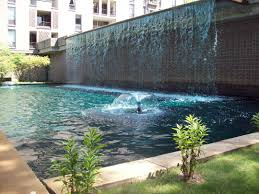 swimming pool water fountain design homesfeed floating with palms
