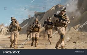 squad fully equipped armed soldiers running stock photo 675995530