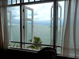 view over the endless blue of the malacca strait from one of the