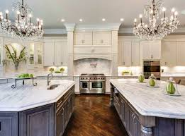 kitchens with two islands beautiful kitchen with white cabinets two islands two chandeliers