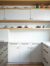 Remodeling  Cutout Cabinet Pulls Remodelista - Kitchen cabinets oakland