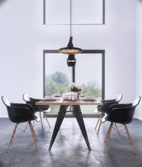 solid wooden dining table with black chairs for modern dining room