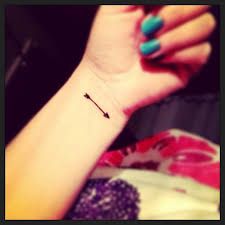 arrow with bow tattoo on inner wrist photos pictures and