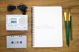 blank paper to write on recreation set top view with blank paper and cassette player stock