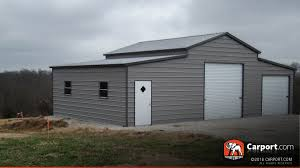 new hampshire carports metal buildings and garages ridgeline barn used as a metal barn workshop with two garage doors and one man door