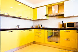yellow kitchen ideas with kitchen cabinet and tile backsplash