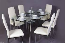 glass square dining table set and 6 cream chairs faux leather