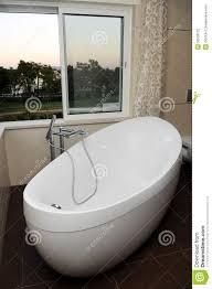 luxurious and modern white bathtub window view stock photo