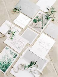fine art wedding stationery styled with olive tree sprigs and
