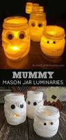 hallwoeen mummy mason jar luminaries easy halloween craft and holidays