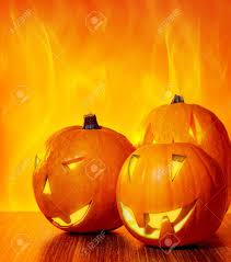 autumn halloween background halloween glowing pumpkins over bright fire yellow background