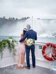 groom waiting in the mist and rain right under niagara falls