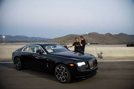 roll royce star rolls royce motor cars u0027 black badge wraith makes worldwide debut