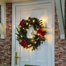 battery lights for wreaths outdoor green battery pre lit wreath with red poinsettias
