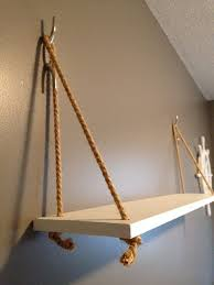 this is a nautical themed hanging shelf made with painted wood and